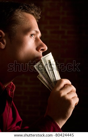 portrait of a man with money in a shirt