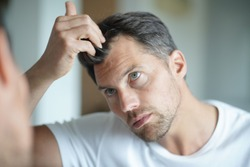 Portrait of a man worried about hair loss