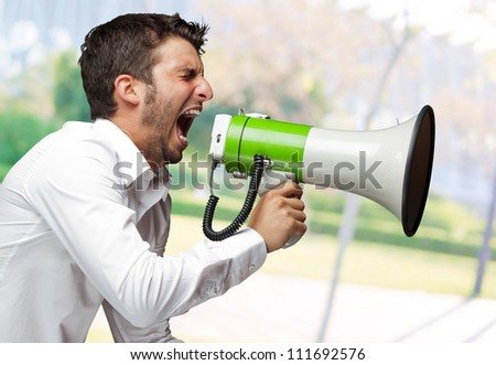 Portrait Of A Man Yelling Into A Megaphone, Outdoor