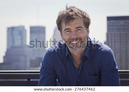 Shutterstock Portrait Of A Mature Active Man Smiling In a city