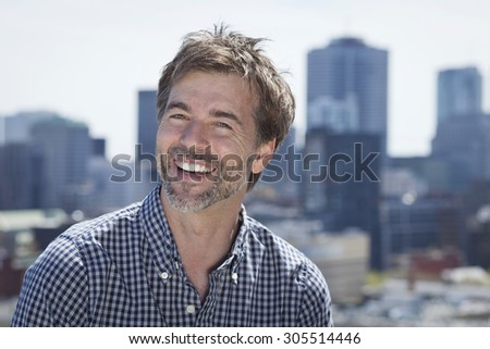Portrait Of A Mature Active Man Smiling In a city #305514446