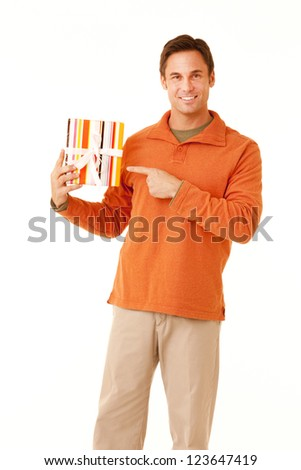 stock photo portrait of a mature adult man wearing an orange sweater and khakis holding a wrapped gift isolated 123647419 vanessa hudgens pic scandaltures: Hot photo scandal: Vanessa Hudgens nude ...