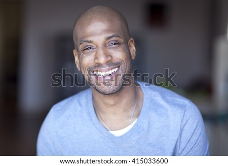 Portrait Of A Mature Black Man Smiling At Home #415033600