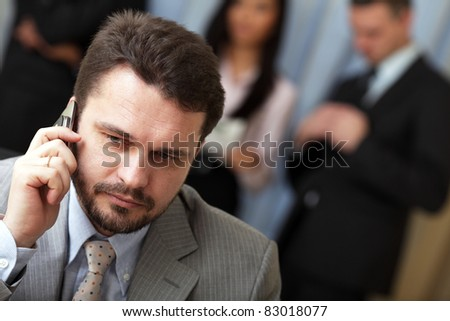 stock photo portrait of a mature business man on phone in office environment 83018077 stock photo : Indian mature business man with mobile phone