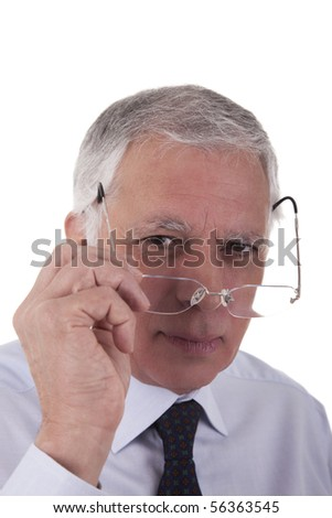 Portrait of a mature  businessman,putting the glasses,  on white background, studio shot