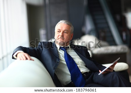 Portrait of a mature businessman with digital tablet #183796061