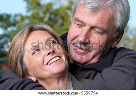 Portrait of a mature couple smiling to each other.