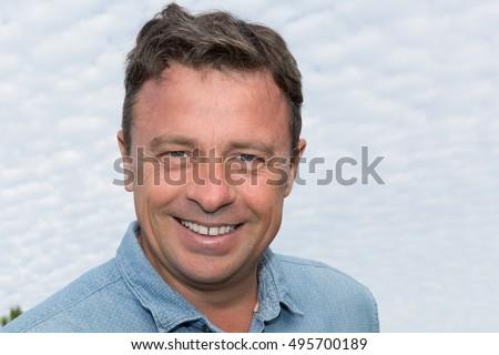 Portrait of a mature handsome man smiling #495700189