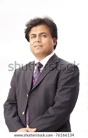 portrait of a mature Indian businessman. - stock photo