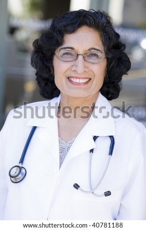 stock photo : Portrait of a Mature Indian Female Doctor Standing Outdoors