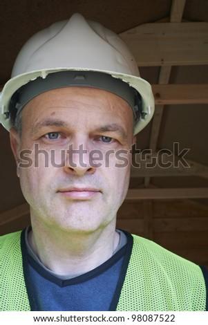 portrait of a mature male builder wearing hard hat