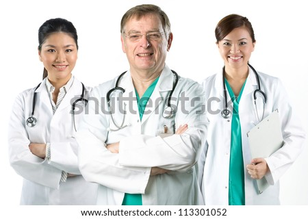 Portrait of a Mature male doctor standing with his team.