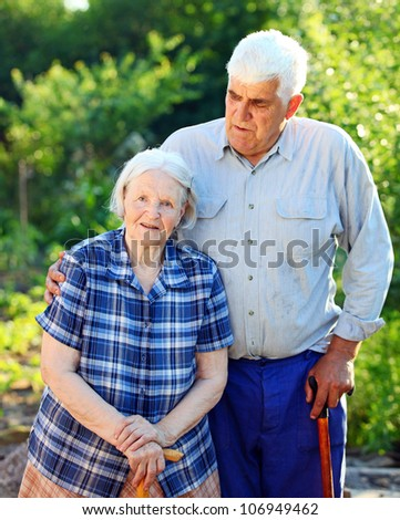 Portrait of a mature man and his senior mother outdoors
