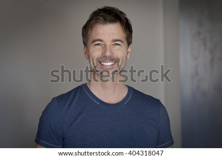Portrait of a mature man smiling at the camera #404318047