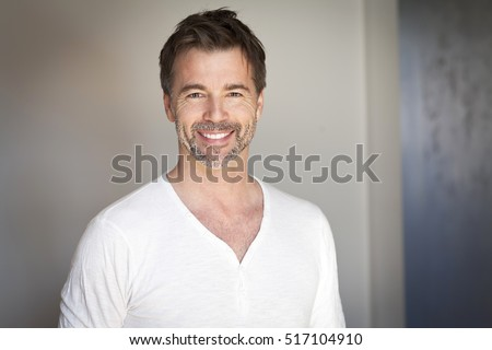 Portrait Of A Mature Man Smiling At The Camera #517104910