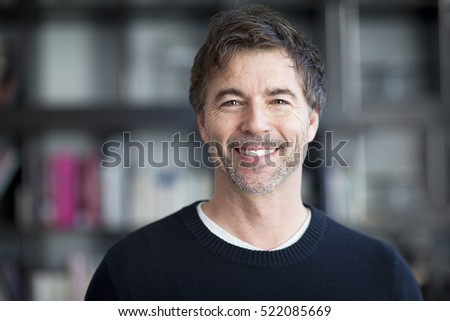 Portrait Of A Mature Man Smiling At The Camera. #522085669