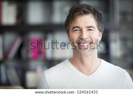 Portrait Of A Mature Man Smiling At The Camera. Home