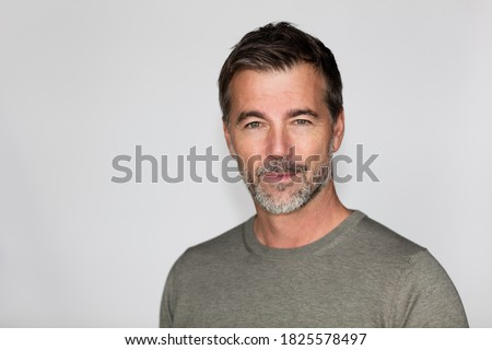 Portrait Of A Mature Man with a Little smile At The Camera. Right side of the picture.  ストックフォト ©