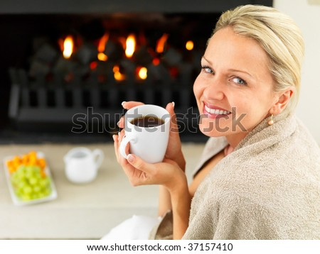 stock photo portrait of a mature woman by the fireplace having a hot cup of coffee 37157410 A BBW Walking Swimsuit from BODacious