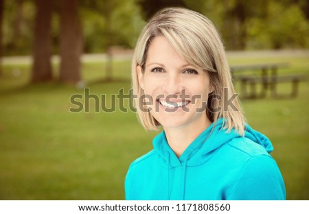 Portrait Of A Mature Woman Smiling At The Park #1171808560