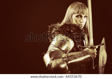 Portrait of a medieval female knight in armour over black background.