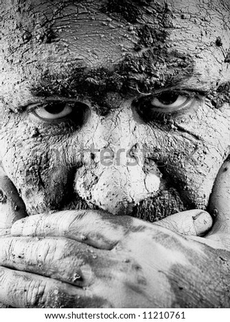 Portrait of a men covered with mud