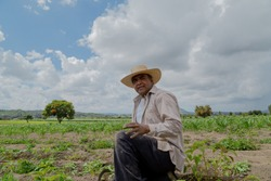 portrait of a Mexican farmer cultivating amaranth