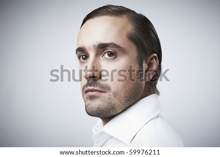 Portrait of a middle age businessman standing against isolated studio background