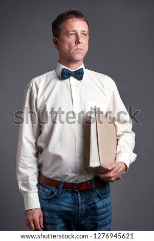 ec3223c3e7eb Man with bow tie and suspenders… Stock Photo 350343215 - Avopix.com