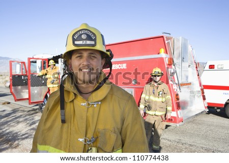 Portrait of a middle aged hispanic firefighter