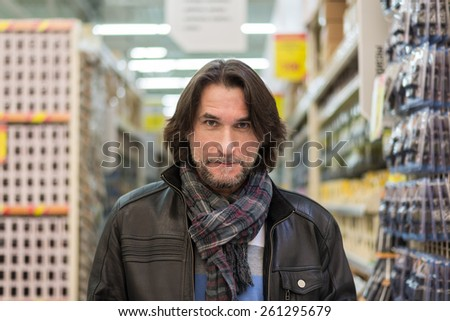Portrait of a middle-aged man in a store building materials