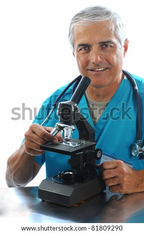 Portrait of a middle aged medical professional seated at a lab table with a microscope, Vertical format isolated on white.