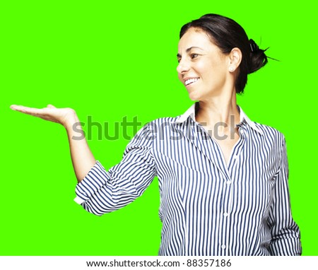 portrait of a middle aged woman holding gesture against a removable chroma key background stock photo