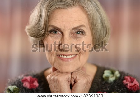 Portrait of a middle-aged woman isolated on colored background - stock photo