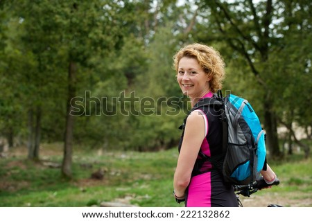Portrait of a middle aged woman smiling with bicycle