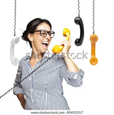 portrait of a middle aged woman talking on vintage telephone over white