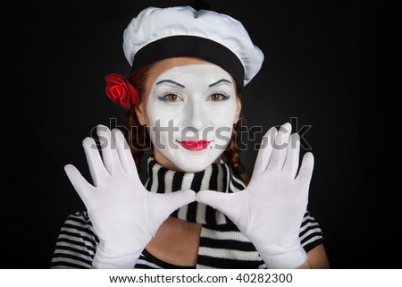 Portrait of a mime comedian,on black background