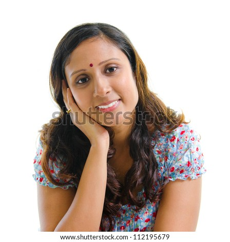 Portrait of a modern Indian woman smiling, isolated on white background