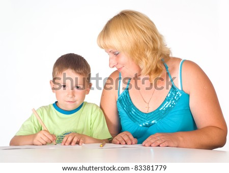portrait of  a mom and her son at table
