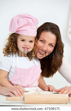 Portrait of a mother and daughter at a table in the kitchen