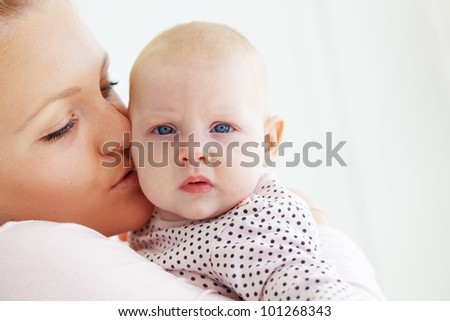 Portrait of a mother with her little baby
