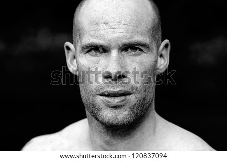 Portrait of a muscular athlete with sweat after exercise