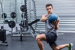 Portrait of a muscular man doing medecine ball exercises