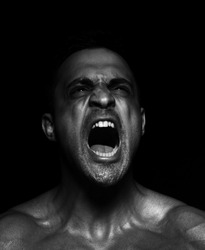 Portrait of a muscular man screaming