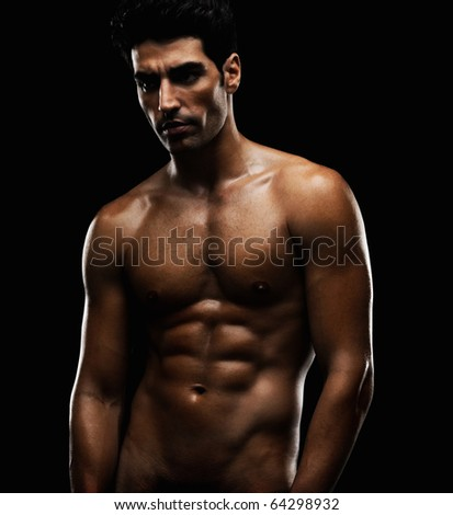 stock photo : Portrait of a naked muscular man against black background