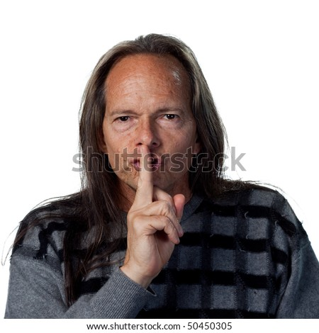 Portrait of a native american man telling people to be quiet