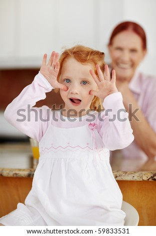 stock photo : Portrait of a naughty girl making funny face while a mature ...