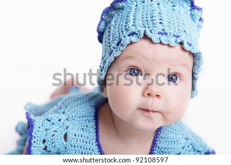 Portrait of a newborn baby girl indoors