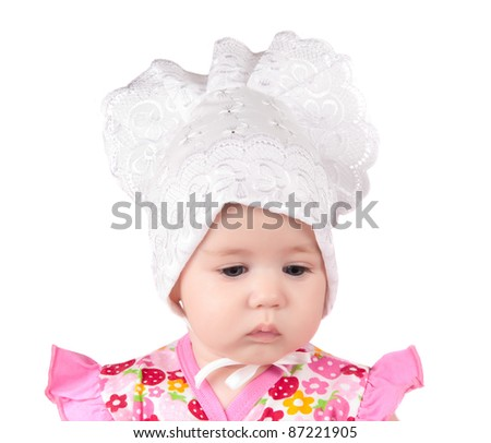 portrait of a newborn girl on a white background