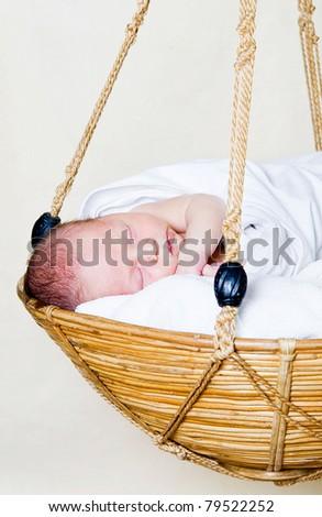 Portrait of a newborn in a basket